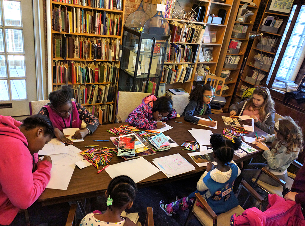 Girl Scouts on a field trip create their own story based on local Chicago media at Read/Write Library