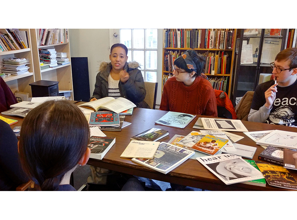 Students from DePaul discuss Chicago media representation at Read/Write Library on a field trip